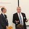 Jon Abele von BearingPoint (links) und Christian Korff von Cisco begrüßen die Finalisten des 15. E-Government-Wettbewerbs in Berlin.
