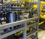 Der 200 kW-Generator befindet sich in der Mitte der Gasentspannungsturbine FIMA GET 200 (vorne links).