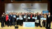 """Gewinner des Wettbewerbs """"Klimaaktive Kommune 2017"""" mit Gratulanten."""