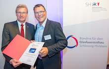 Wirtschaftsminister Dr. Bernd Buchholz (l.) und SWN-Geschäftsführer Thomas Junker wollen den Glasfaserausbau im Land vorantreiben.