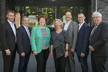 Münster: Fünf der neuen Mitglieder der IT-Anwendergemeinschaft werden willkommen geheißen.