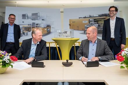 Vertragsunterzeichnung mit Siemens.