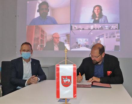 Landkreis Börde: Virtuelle DMS-Vertragsunterzeichnung.